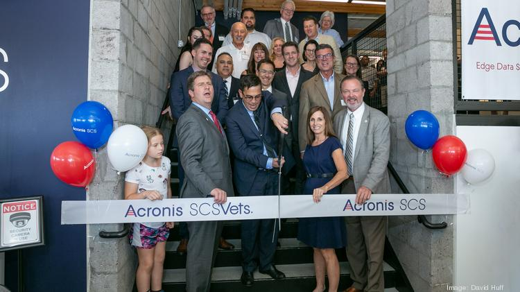 Acronis SCS CEO John Zanni officially opens his company's Scottsdale office Oct. 8, 2019 with local city and business leaders, including Congressman Greg Stanton, Sen. Martha McSally and Scottsdale Mayor Jim Lane.