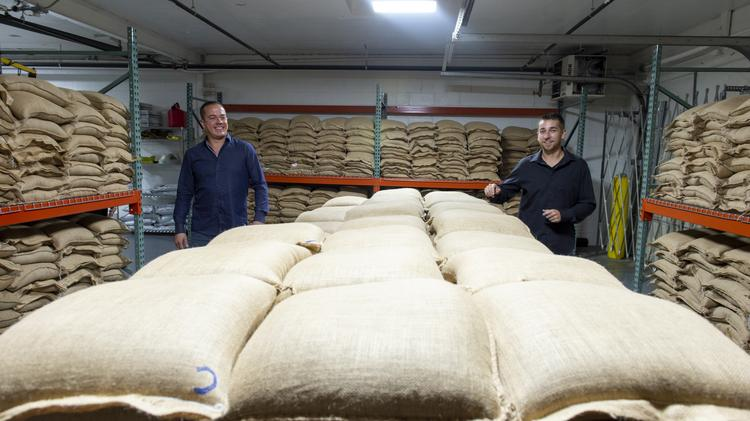 Hemp Depot co-founders Andy Rodosevich and Luke Pickering walk past hemp CBD seeds valued at $7,500 per bag. The room contains about 55,000 seeds and $16.5M in current inventory.