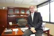 "Orlando Health Vice President and Chief Information Officer John ""Rick"" Schooler. Salary in 2011: $494,399"