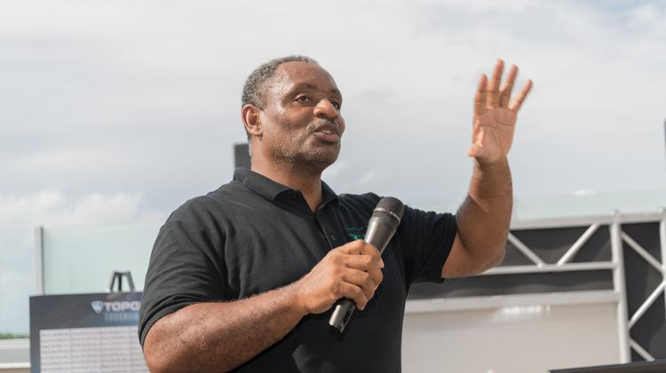 Tony Thompson of Kwame Building Group speaking at the Kwame Foundation's annual golf tournament in 2019.