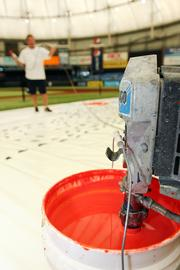 Paint being mixed before being sprayed on the field.