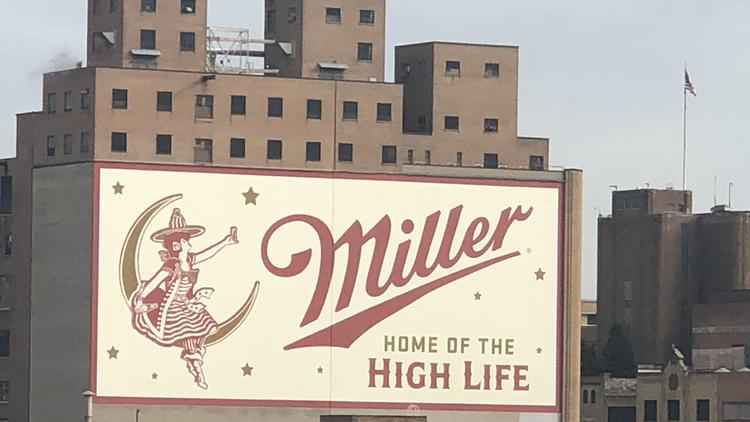 """Miller Brewing Co. recently repainted the """"Girl In The Moon"""" sign on the side of the brewery in the Miller Valley."""