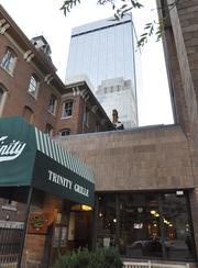 "Bill Husted interviews Bill Mosher and Molly Broeren at the Trinity Grille, once described as a ""men's clubby"" sort of place, a favorite of oil and gas executives and financial services people"