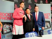 Rockets forward Chandler Parsons, shown during a ZTE promotion with ZTE officials, has been offered a contract by the Mavericks.
