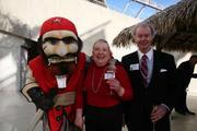The Tampa Bay Buccaneers mascot Capt. Fear with Linda Burek and Brian Burek with Brimmer Burek & Keelan LLP.