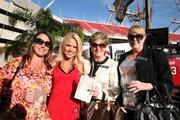 Jennifer, Christie and Melissa with Innisbrook pose with a Buccaneers cheerleader.