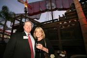 David Doney with Akerman Senterfitt and Melinda MacConnell with Odyssey Marine enjoy the party.