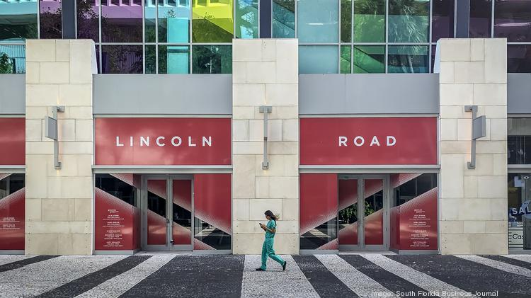 A lone pedestrian makes their way along the Lincoln Road Mall, in Miami Beach.