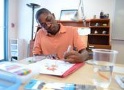 Elite student Aaron Randolph works on a character he is developing for a comic book project.