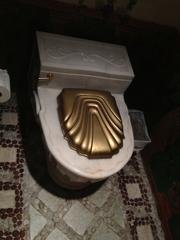 Ornate marble toilet at the Versace mansion.