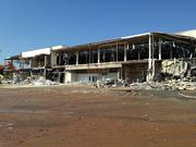 Demolition crews began ripping down the former Burlington Coat Factory at the shuttered Eastland Mall over the weekend.