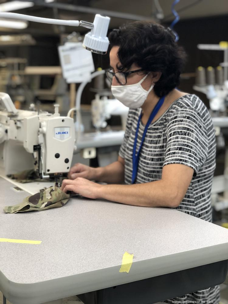 An employee at Industries of the Blind in Greensboro sews a face mask that will be used by a soldier in the U.S. Army.