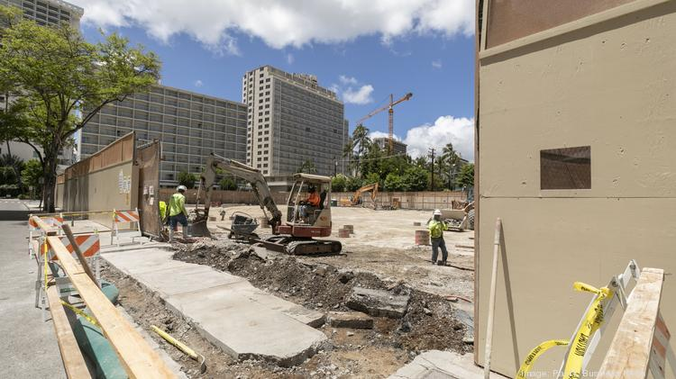 Workers are seen on the site of the Hilton Grand Vacations project in Waikiki, which has been put on hold during the Covid-19 pandemic.
