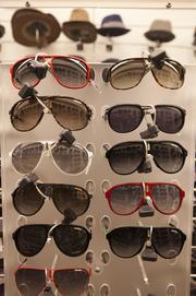 Men's sunglasses on display at Nordstrom Rack.