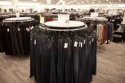 Women's jeans are on display in the middle of the store.
