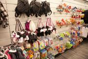 Kids' purses and toys hang on the wall at Nordstrom Rack.