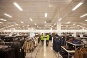 Nordstrom Rack employees walk through the new store while preparing for the opening on Thursday.