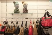 Purses, scarves and toboggans are on display at Nordstrom Rack.