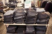 Men's jeans are shown inside Nordstrom Rack.