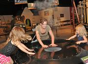 Kristin Page with daughters (left) Lily and Madison, at MiSci's cloud ring exhibit