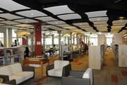 The library located on the second floor of the new Sullivan Center for Innovation and Leadership at Iolani School has a modern but industrial design with ceiling panels that buffer sound and yet keep cables and wires organized and out of sight.