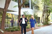 BECO South President Chris Epstein and leasing director Mercedes Merritt stroll through the Innovation Park campus.