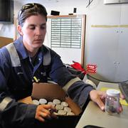Marisa Manning, Baker Hughes engineer, sorting sample jars.