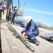 Marisa Manning, Baker Hughes engineer, unloading the core gun.