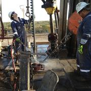 Sergio DeLeon and Ernest G. Guerrero Jr. work a rig for Baker Hughes in Duval County.