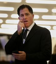 Michael Dell, chairman and chief executive officer of Dell Inc., speaks to fellow delegates in the Congress Center on day three of the World Economic Forum (WEF) in Davos, Switzerland, on Friday, Jan. 25, 2013. World leaders, influential executives, bankers and policy makers attend the 43rd annual meeting of the World Economic Forum in Davos, the five day event runs from Jan. 23-27. Photographer: Jason Alden/Bloomberg *** Local Caption *** Michael Dell