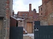 An old carriage house behind 207 Broadway will be renovated to create a private party room and rear entrance to the wine bar/coffee shop.