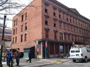 """Built in 1876, the four-story, 10,900-square-foot building at 207 Broadway was once home to a boarding house and hotel called """"The Clark House."""" The building is in serious disrepair today."""