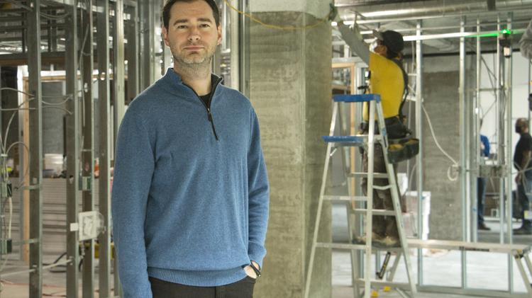 Erik Tucker, Aronora's COO, stands in the biotech company's new space, which is being prepared for a February move-in. The buildout was funded in part with Oregon State Lottery funds administered by the Oregon Business Development Dept.