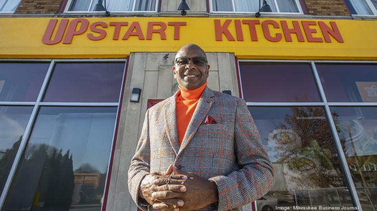Bishop Walter Harvey stands outside Upstart Kitchen in Milwaukee's Sherman Park neighborhood.