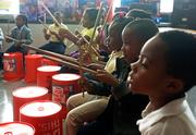 Students new to the OrchKids program participate in the Bucket Band under the direction of Brian Prechtl, a member of the Baltimore Symphony Orchestra, at Mary Ann Winterling Elementary School.