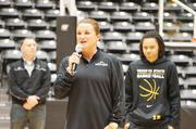 Wichita State University Women's Basketball Team Head Coach Jody Adams talks to the crowd at Sunday's welcome home event. The women's team  was welcomed first, and was met with a standing ovation from the crowd.