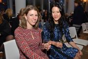 Kate Shmidt and Alicia Lee of Goldman Sachs Group Inc., attend the Women's World Banking gala.