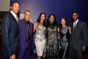 Christopher Williams, chairman and chief executive officer of Williams Capital Group LP, from left, actors Laurence Fishburne and Gina Torres, Janice Savin, senior principal at Williams Capital Group LP, Yvette Campbell, president and chief executive officer of Harlem School of the Arts, and Michael Campbell, chief operating officer of Cofinance Inc., attend a gala for the Harlem School of the Arts at Jazz at Lincoln Center's Allen Room in New York, on Tuesday, Oct. 8. The school teaches acting, dance, theater and music.