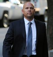 George Perez, a former programmer at Bernard L. Madoff Investments Securities LLC, arrives at federal court in New York on Oct. 8.