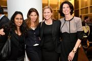 Morgan Stanley employees Kads Bennurkar, from left, Michelle May, Tara McCabe and Maureen O'Toole, attend the Women's World Banking gala at the IAC Building in New York on Wednesday, Oct. 9. Microfund for Women in Jordan was honored.