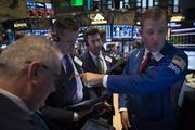 Traders work on the floor of the New York Stock Exchange in New York on Wednesday, Oct. 9. U.S. stocks rose, after the benchmark index's biggest two-day slump since June, amid optimism that Janet Yellen will not rush to withdraw stimulus and signs that lawmakers could raise the debt ceiling.