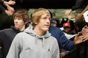 Shocker players enter Charles Koch Arena for Sunday's welcome home event. Evan Wessel, left, Ron Baker, foreground.