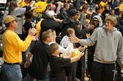 Shocker player Ron Baker led players in front of fans providing high-fives, pictures and autographs during Sunday's Shocker welcome home rally.