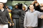 WSU basketball players enter Charles Koch arena Sunday to thundering applause from fans. From Left: Jake White, Fred Van Vleet, Cleanthony Early, Carl Hall, Zach Bush.