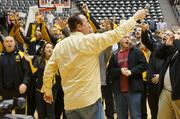 WSU Head Coach Gregg Marshall leads WSU players, band members and fans in a cheer at Sunday's Shocker welcome home rally.