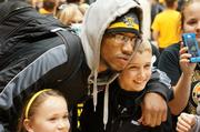 WSU player Carl Hall poses for photos after Sunday's welcome home rally.