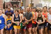 Runners line Calvert Street on Saturday for the start of the Baltimore Half Marathon. Some 13,000 people participated in the 13.1-mile race.