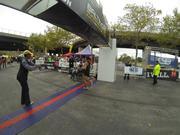 Dave Berdan crosses the finish line as the winner of the 2013 Baltimore Marathon.