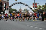 The Baltimore Marathon begins near Oriole Park at Camden Yards. Around 4,000 runners participated in the 26.2-mile race. In all, 27,000 runners participated in the days various events.