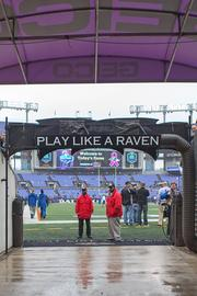 "A look at the M&T Bank Stadium tunnel where the Ravens are introduced prior to the start of home game. A sign that reads ""Play Like A Raven"" greets the team."
